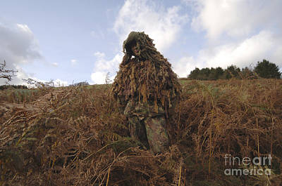A Sniper Dressed In A Ghillie Suit Print by Andrew Chittock