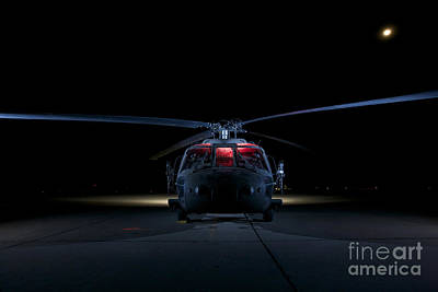 A Uh-60 Black Hawk Helicopter Lit Print by Terry Moore