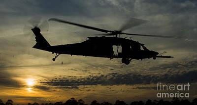 A U.s. Army Uh-60 Black Hawk Leaves Print by Stocktrek Images