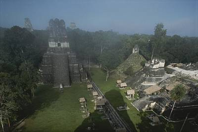 A View Of Mayan Ruins At Tikal Print by Kenneth Garrett