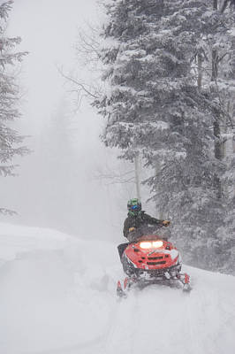 Snowmobile Photograph - A Woman Speeds Along On A Snowmobile by Taylor S. Kennedy