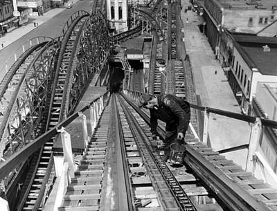 1930s Candid Photograph - A Workman Greases Up The Tracks by Everett