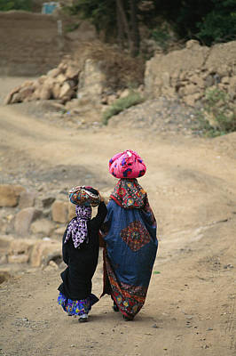A Yemeni Woman And Child Carrying Print by Michael Melford
