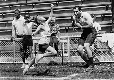 Tape Player Photograph - A Young Athlete Sprinting by Underwood Archives