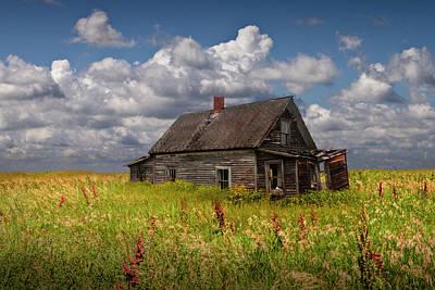 Abandoned Prairie Farm House Under Cloudy Blue Skies Print by Randall Nyhof