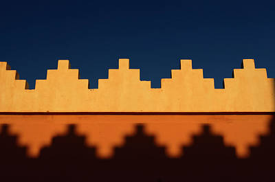 Morocco Photograph - Abstract Pattern Of Crenellations Of Yellow Orange And Blue Sky  by Reimar Gaertner