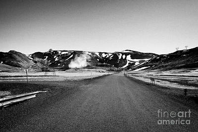 access road and outbuildings of the hellishedi geothermal power station Iceland Print by Joe Fox