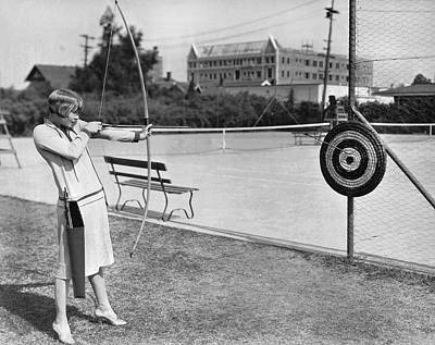 Movie Star Photograph - Actress Shooting An Arrow by Underwood Archives