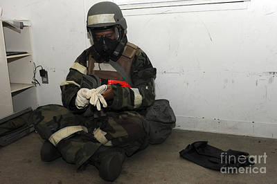 Camouflage Clothing Photograph - Airman Dons His Chemical Warfare by Stocktrek Images