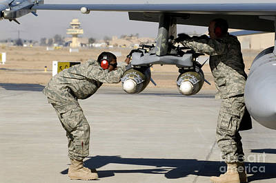 Camouflage Clothing Photograph - Airmen Inspect F-16 Fighting Falcon by Stocktrek Images