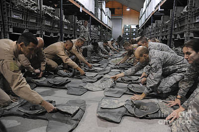 Camouflage Clothing Photograph - Airmen Inspect Their Improved Outer by Stocktrek Images