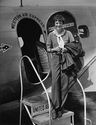 Airliners Photograph - Amelia Earhart 1897-1937 Standing by Everett