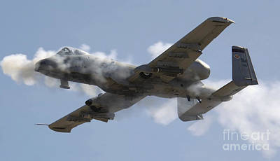 An A-10 Thunderbolt II Fires Its 30mm Print by Stocktrek Images