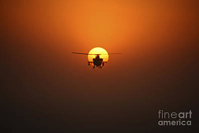 An Ah-64d Apache Helicopter Flying Print by Terry Moore
