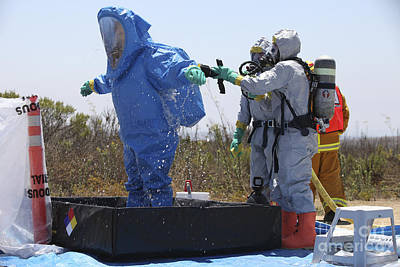 Safeguard Photograph - An Airman Stands In A Tub Of Cleaning by Stocktrek Images