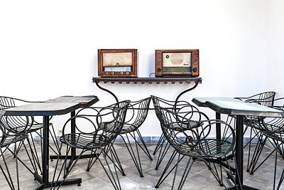 Photograph - An Arrangement Of Tables And Chairs And Two Old Radios by Regina Koch