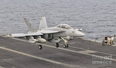 On The Runway Photograph - An Ea-18g Growler Landing On The Flight by Giovanni Colla