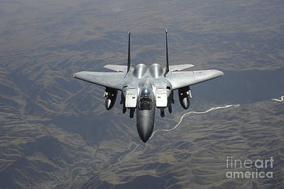 An F-15e Strike Eagle Flies Watch Print by Stocktrek Images