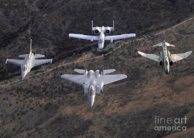 An F-16 Fighting Falcon, F-15 Eagle Print by Stocktrek Images