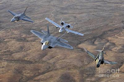 F-22 Photograph - An F-22a Raptor, An F-4 Phantom, An by Stocktrek Images