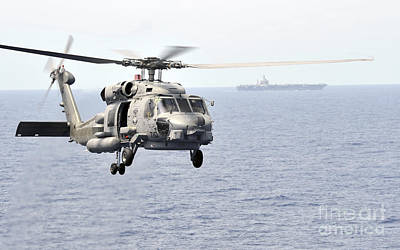 Photograph - An Mh-60r Seahawk Helicopter In Flight by Stocktrek Images