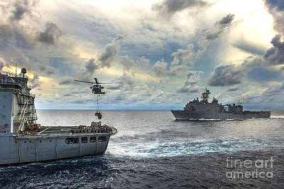 U.s. Navy Painting - An Mh-60s Sea Hawk Helicopter  Lifts Pallets Of Supplies by Celestial Images