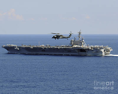 Photograph - An Mh-60s Seahawk Helicopter Flies by Stocktrek Images