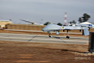 An Mq-1c Sky Warrior Uav Lands At Camp Print by Stocktrek Images