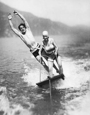 Young Man Photograph - Aquaplaning Couple by Underwood Archives