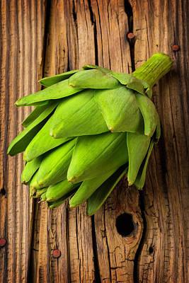 Artichoke Photograph - Artichoke On Old Wooden Board by Garry Gay