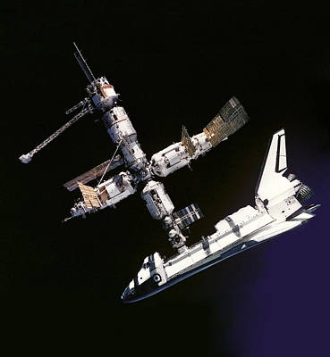 Atlantis Shuttle Docked To Space Station Print by Daniel Hagerman
