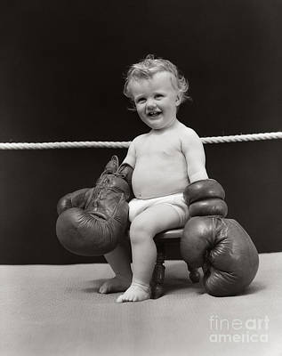 Boys Boxing Photograph - Baby In Boxing Gloves, C. 1930s by H. Armstrong Roberts/ClassicStock