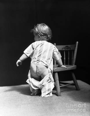 Seated Nude Girl Photograph - Baby With Unbuttoned Pajamas, 1930s by H. Armstrong Roberts/ClassicStock