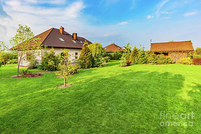 Estate Photograph - Backyard Of A Family House. Spacious Landscaped Garden With Green Mown Grass by Michal Bednarek