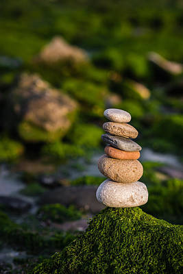 Balancing Zen Stones By The Sea Print by Marco Oliveira