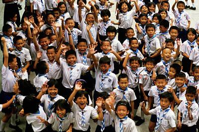 Bangkok School Children Jumping And Smiling At The Camera Print by Sami Sarkis
