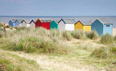 Beach Huts Print by Ian Merton