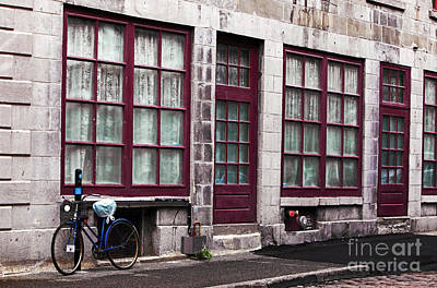 Bicycle In Old Montreal Print by John Rizzuto