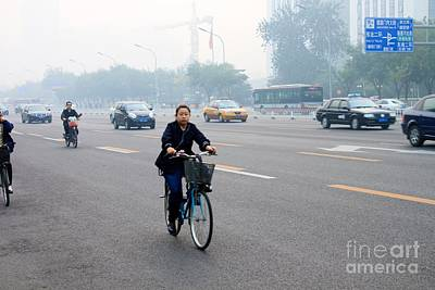 Bicyclist In Beijing Print by Thomas Marchessault