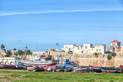 Photograph - boats were repaired in front of the walls of the old historic portuguese fortress city El Jadida in  by Regina Koch