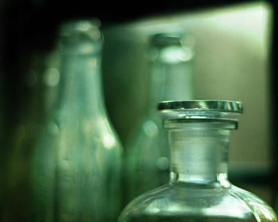 Bottles In The Window Print by Rebecca Sherman