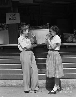 Boy And Girl Eating Hot Dogs, C.1950s Print by H. Armstrong Roberts/ClassicStock