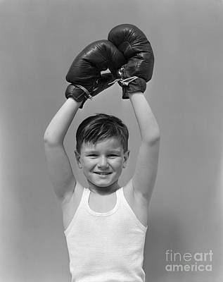 Boys Boxing Photograph - Boy Raising Boxing Gloved-hands by H. Armstrong Roberts/ClassicStock