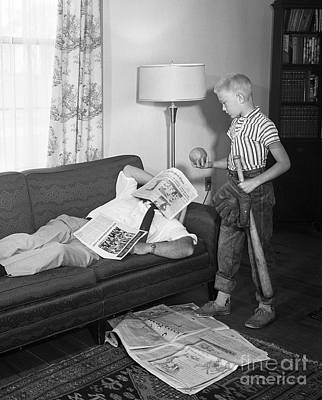 Bat Boy Photograph - Boy With Baseball Vs. Napping Dad by D. Corson/ClassicStock