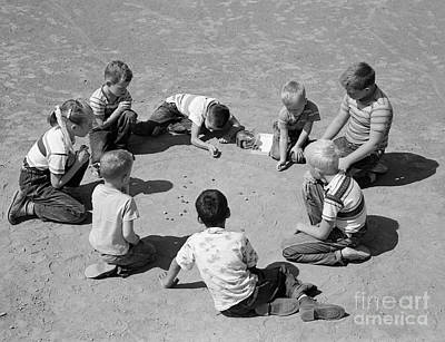 Tomboy Photograph - Boys And One Girl Shooting Marbles by D. Corson/ClassicStock