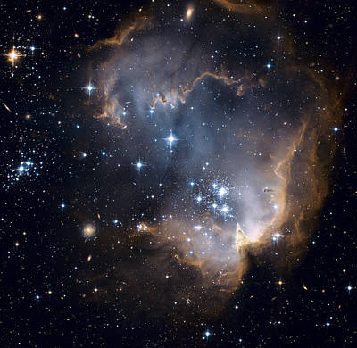 Photograph - Bright Blue Newborn Stars Blast A Hole by ESA and nASA