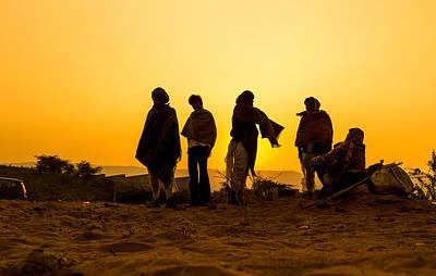 Sunset Photograph - Camel Herders At Pushkar by Vijay Bihani