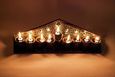 Israel Photograph - Ceramic Chanukkiah Lit With Eight Lights And One Lighter, The Shamash, Viewed From The Top by Yoel Koskas