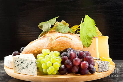 Cheese Plate With Red And Green Wine Grapes Print by Wolfgang Steiner