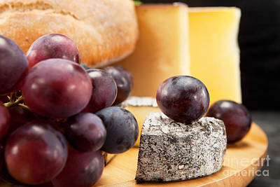 Cheese Plate With Red Wine Grapes And White Bread Print by Wolfgang Steiner